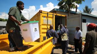 Election officials and ballot boxes from the 2012 PNG General election