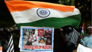 Activists and supporters of the Jamiat Ulama-i-Hind, an Indian Islamic organisation, hold India's national flags and placards as they take part in a 'Peace March' protest rally in New Delhi on August 13, 2017