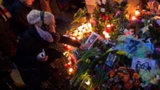 Flowers, candles and photographs are placed in front of the apartment building where David Bowie once lived in Berlin (11 Jan)