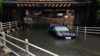 A marooned vehicle in middle of a flash flooding in south London