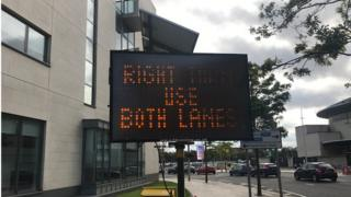Traffic directions near Queen's Road in Belfast