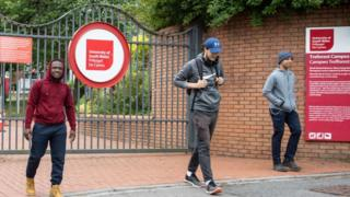 Students socially distance as they leave the University of South Wales campus in Treforest