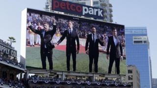 The Tenors perform the Canadian National Anthem prior to the MLB baseball All-Star Game in San Diego.