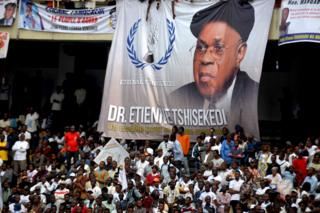 A banner dedicated to Etienne Tshisekedi, former Congolese opposition figurehead who died in Belgium two years ago, is seen hanging above supporters during a mourning ceremony at the Martyrs of Pentecost Stadium in Kinshasa, Democratic Republic of Congo May 31, 2019