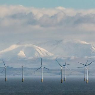 Robin Rigg Wind Farm and the Cumbrian fells from Balcary Point, Dumfries and Galloway, Scotland.
