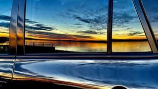 Sunset reflection on car