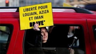 A protester in Paris calling for the release of detained Saudi women's rights activists