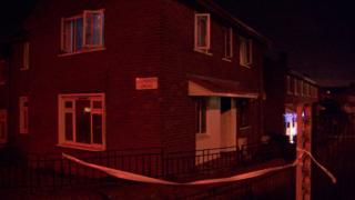 The fire happened shortly after 17:00 GMT at a ground-floor flat on the corner of Ardoyne Road and Glenbryn Drive