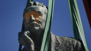 A defaced statue of Cecil Rhodes is removed from the University of Cape Town in 2015