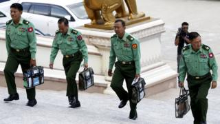 Military parliament members arrive for Myanmar's first parliament meeting after November 8th general elections, at the Lower House of Parliament in Nay Pyi Taw November 16, 2015.