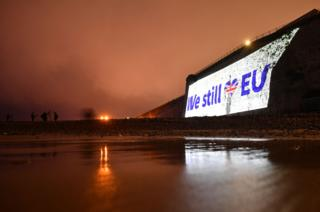 A pro-EU message is projected onto the cliffs in Ramsgate, southern England