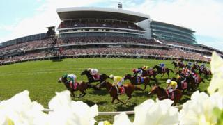 Thousands line the track at Flemington Racecourse for the world-renowned Melbourne Cup