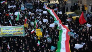 Iranian pro-government supporters march during the funeral of a young member of the Revolutionary Guards, Sajjad Shahsanai, in the city of Najafabad, west of Isfahan, on Wednesday