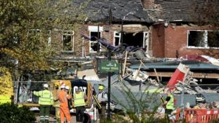 Emergency services work at the scene of a suspected gas explosion in New Ferry