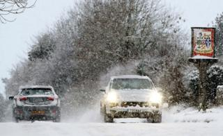 Cars travel through Great Chart in Ashford, Kent, following heavy overnight snowfall
