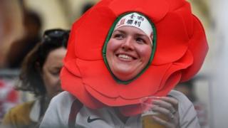 Woman with poppy headgear