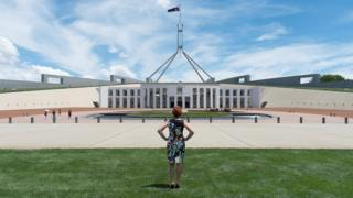 Pauline Hanson standing in front of Parliament House in Canberra