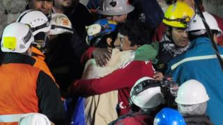 Chilean miner Jimmy Sanchez is welcomed by his father after being rescued from the San Jose mine