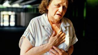 Woman with chest pain file picture