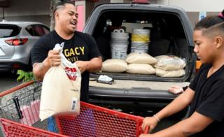 Residents have been purchasing sandbags and plywood ahead of the hurricane's arrival