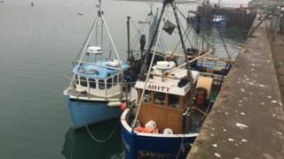 The two boats are tied up at Clogherhead Harbour in County Louth