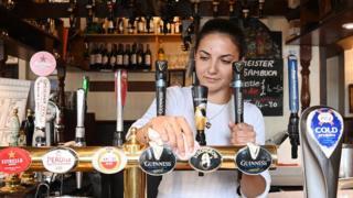 A woman cleans a bar