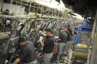 "Nissan technicians prepare doors for the Qashqai car at the company""s plant in Sunderland"