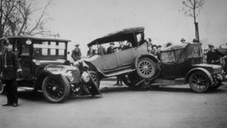 Old-fashioned cars in pile-up