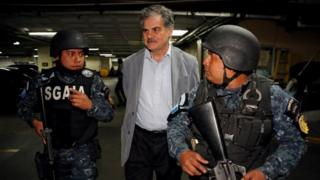 Former finance minister and current chairman of Oxfam International Juan Alberto Fuentes arrives to court escorted by policemen after being detained as part of a local corruption investigation, in Guatemala City, Guatemala February 13, 2018.