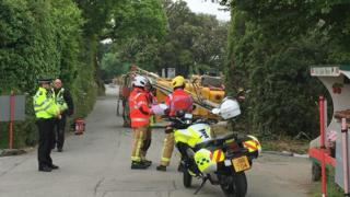 Emergency services at the scene of the overturned tractor