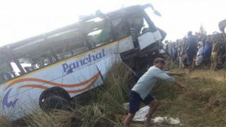 The scene of a bus accident in India's Rajasthan state, in which at least 32 people were killed, 23 December 2017