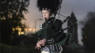 boy playing bagpipes