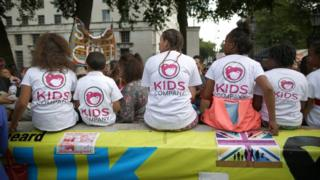 People wearing Kids Company t-shirts