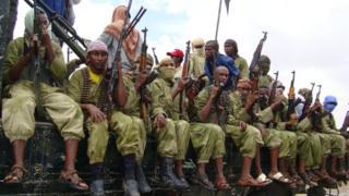 Al-Shabab fighters sit on a truck as they patrol in Mogadishu
