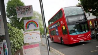 Bus going past pictures stuck on bus stop