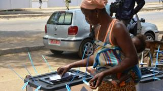 A woman cast her vote at a polling station in Conakry, Guinea - Sunday 22 March 2020