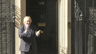 Prime Minister Boris Johnson takes part in the clap from outside Downing Street