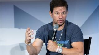 Mark Wahlberg speaking onstage