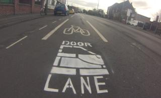 """Cycle lane marked with """"door lane"""" on Haydn Road in Sherwood, Nottingham"""