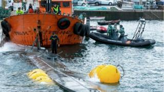 Guardia Civil divers inspect the suspected narco-submarine in Aldán, Galicia