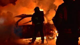 Firefighters tackle car blaze