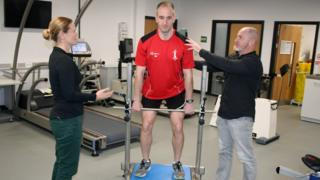 Professor Liam Kilduff and Dr Camilla Knight testing an athlete's core strength