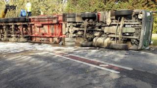Overturned lorry.