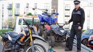 Police officer with off road quad and motor bikes