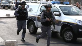 Israeli police rush to scene of a stabbing in Jerusalem on 10 October 2015