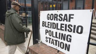 Voter enters polling station in Cardiff