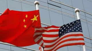 in_pictures Flags of China (left) and the US. File photo