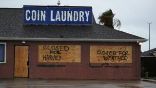 """Sign on a business reading """"closed for Harvey"""""""