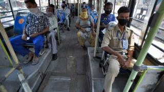 Passengers maintaining social distance as they are on board in a DTC Bus after government eased lockdown restriction, at AIIMS on May 20, 2020 in New Delhi, India.