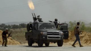 A truck firing a machinegun